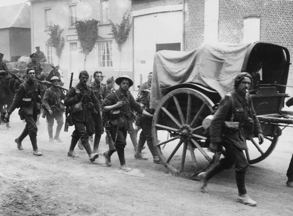 The 10th East Yorkshire Regiment, known as the Hull Commercials, march to the trenches, near Doullens, northern France