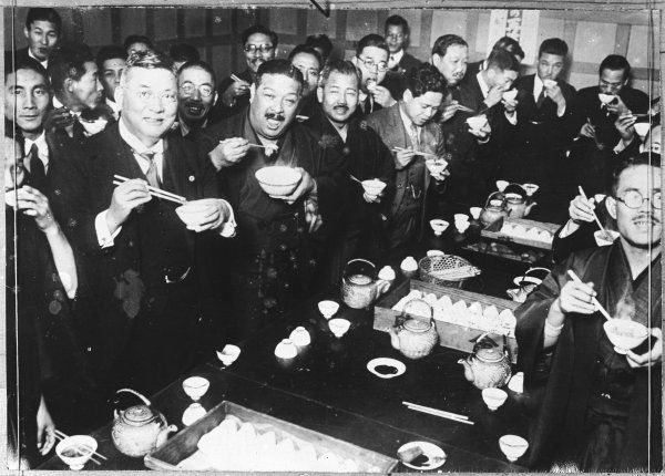 Japanese politicians enjoying a meal using chopsticks, in the canteen of the new parliamentary buildings in Tokyo