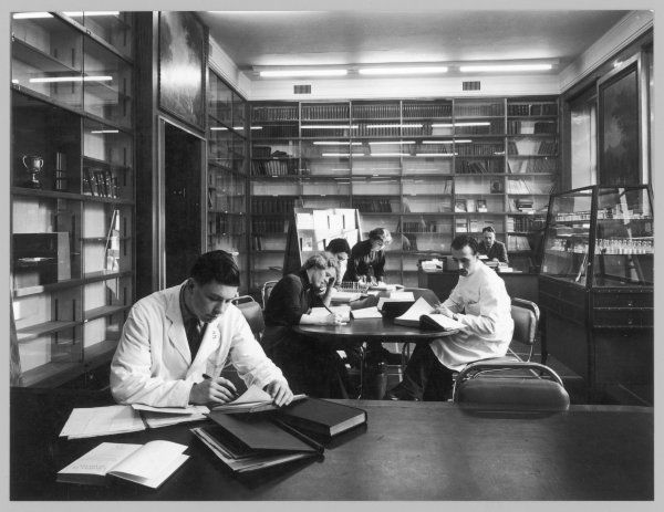 Students at Edinburgh University, apparently studying science, read and make notes in a library