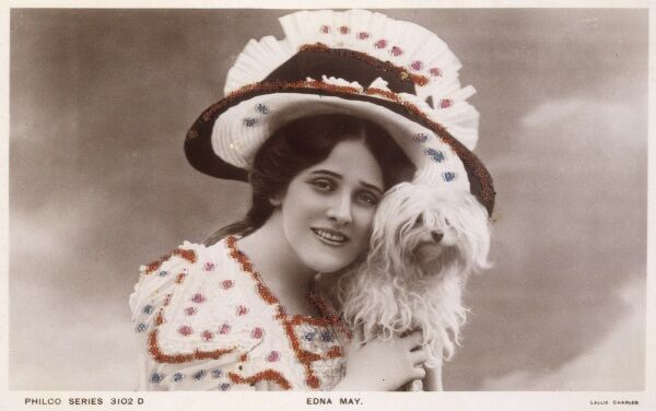 EDNA MAY Actress, wearing an enormous hat and holding her little dog