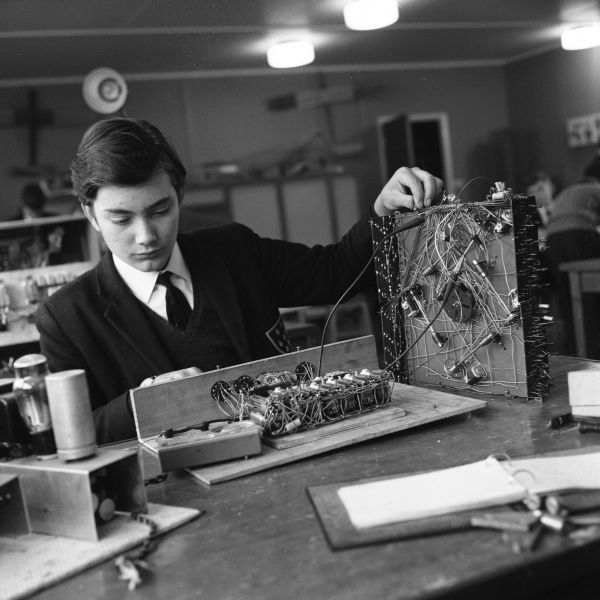 A schoolboy works on early computer circuitry at Sevenoaks School Technical Centre