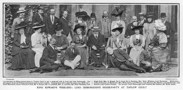 EDWARD VII At a weekend party at Taplow Court owned by Lord Desborough. The King's mistress, Alice Keppel is standing behind him, right