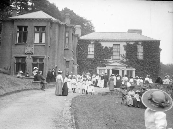 A smart Edwardian garden party taking place in the grounds of a large country house in Crickhowell, Powys, Mid Wales