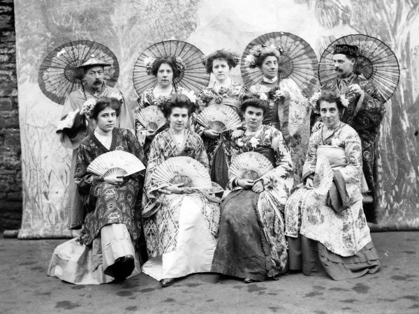 A group of Edwardian performers in oriental costume, with fans and parasols, probably somewhere in Mid Wales. The most likely production would be The Mikado, by Gilbert and Sullivan