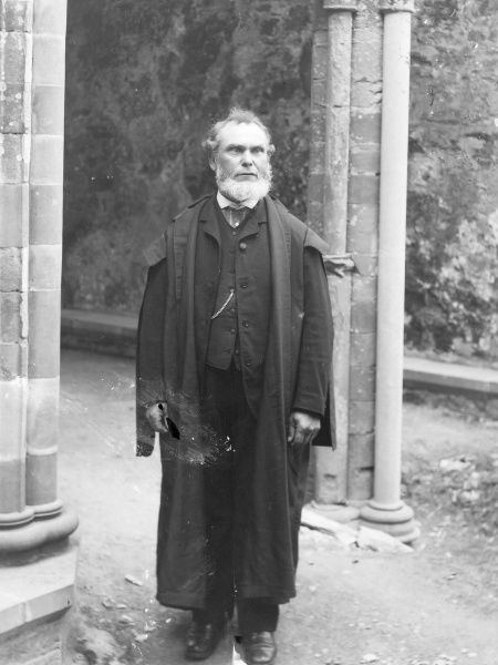 A rather ferocious looking Edwardian schoolmaster in his academic gown, Mid Wales