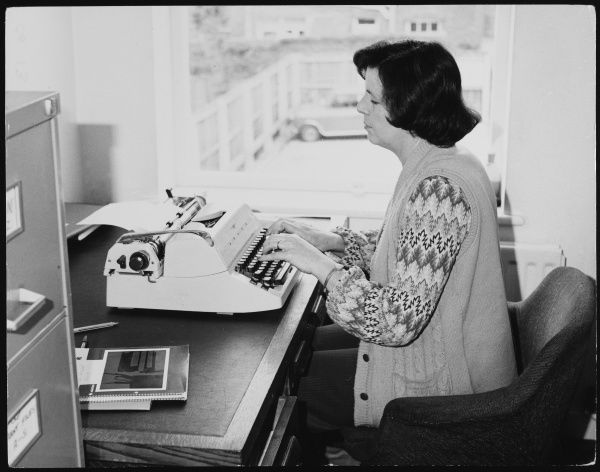 An efficient typist or secretary working at her desk