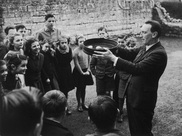 ENGLAND: EGG SHACKLING, STOKE ST GREGORY, SOMERSET. On Shrove Tuesday children take an egg to school. These are gently shaken in a sieve until the strongest shelled egg remains