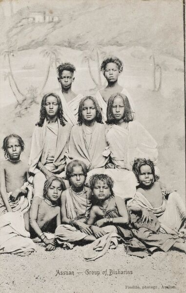 Egypt - a photograph of a group of young Bishari Children. The Bishari (who occupy the land from Baranis in the south to the Port Sudan area) are descended from Neolithic tribal groups of ancient Hamitic origin