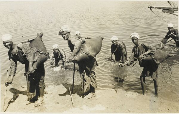 Slightly before Mr Evian, Mr Volvic and Mr Malvern took a firm grip on the market, this is how visitors to Egypt were supplied with 'fresh' drinking water! Here, Egyptian water sellers / carriers fill up their skins with water direct