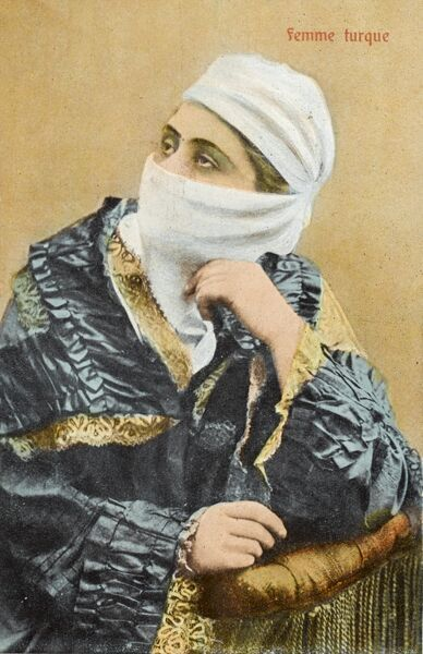 Ottoman Turkish Woman in Egypt, in a very fine and elaborate costume and leaning on the end of a sofa