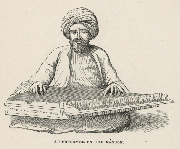 An Egyptian musician performs on the kanoon