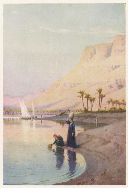 A typically Egyptian riverbank scene of still waters in a sandstone valley