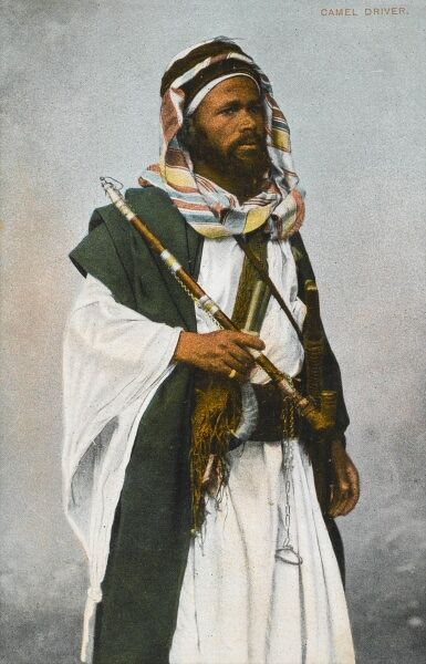 A fine portrait of an Egyptian Tribesman holding a long pipe
