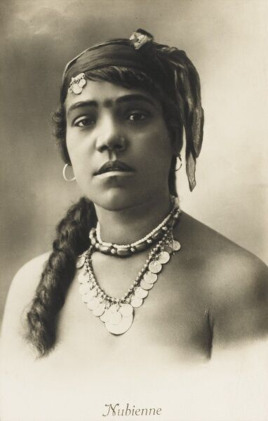 Striking Egyptian woman with gold necklace