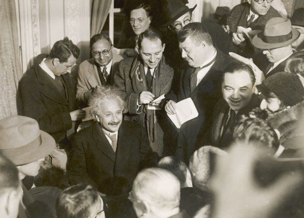 ALBERT EINSTEIN German born physicist. Winner of the Nobel Prize for physics in 1921. Photographed surrounded by reporters