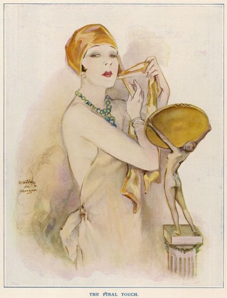 An elegant young woman puts on the final touch at her mirror before going out -- a gold coloured headscarf