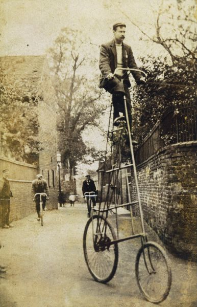 A very elevated bicycle - the look of concentration on the rider's face is very understandable!