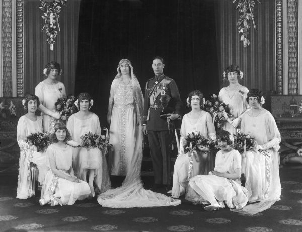 Wedding group photograph on the occasion of the marriage of Lady Elizabeth Bowes-Lyons (later Duchess of York, Queen Elizabeth and the Queen Mother) to Albert, Duke of York on 26th April, 1923 at Westminster Abbey. The couple pose with their eight bridesmaids