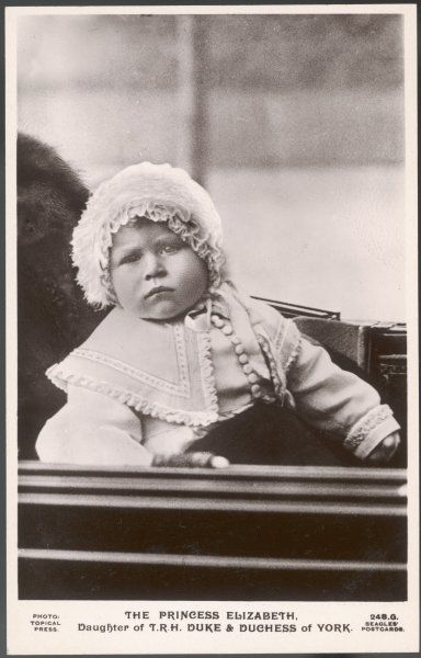 ELIZABETH II in a frilly bonnet, at the age of one