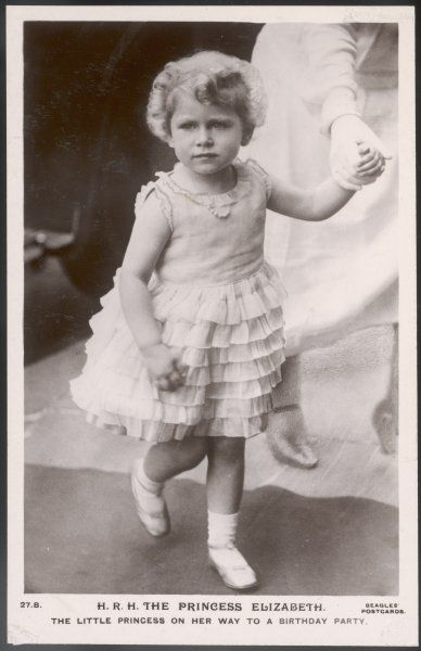 ELIZABETH II in a frilly dress, aged about five