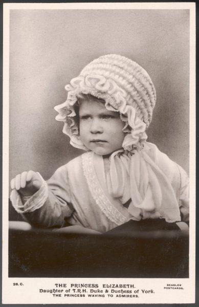 ELIZABETH II as a toddler, waving to admirers