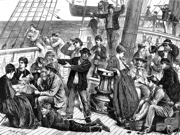 Engraving showing a scene on the deck of an emigrant ship, as the passengers sight land, 1871. In the foreground a lady is sewing and a family with very young children look anxiously towards land. Sailors are using telescopes to confirm the sighting of land