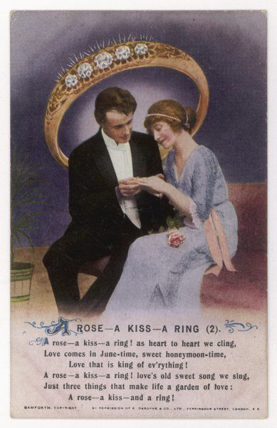 A ROSE - A KISS - A RING She admires the ring he has just slipped onto her finger