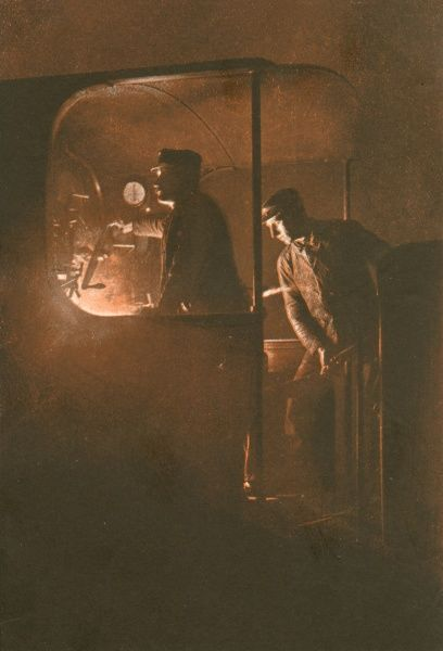 Driver and stoker on the footplate of a night train - a dramatic photograph which effectively captures the excitement of the engine crew's job