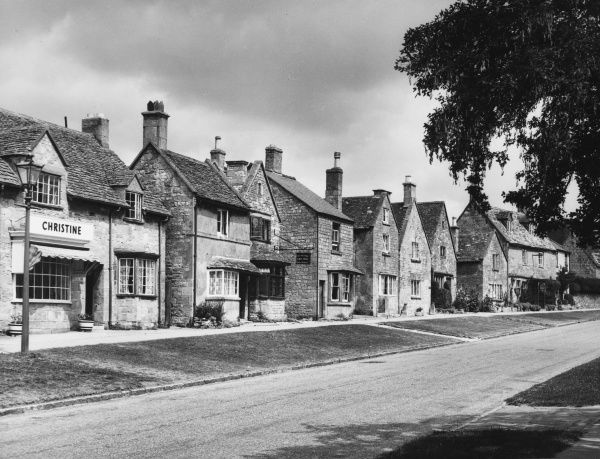 The village of Broadway, Worcestershire, often referred to as the 'Jewel in the Cotswolds', the main street being lined with 16th century limestone buildings