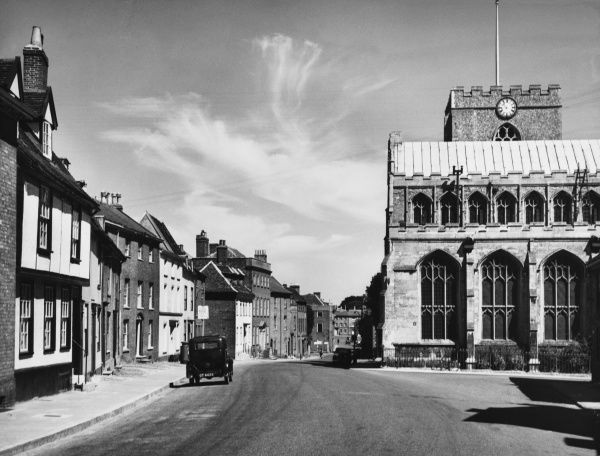 A glimpse of the historic town of Bury St. Edmunds, Suffolk, England, with only a few parked cars on the road