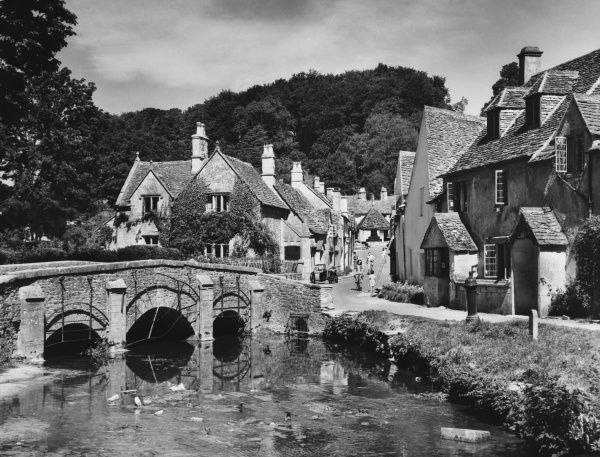 Castle Combe, which lies in a deep hollow in the Wiltshire Downs, some six miles from Chippenham. It is claimed to be one of England's loveliest villages
