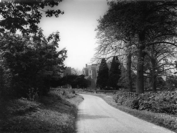 View of the road to the church and Chastleton House, at Chastleton, Oxfordshire, England. Date: early 1960s