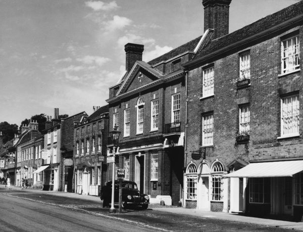 The town of Farnham, Surrey, with no traffic save a solitary taxi in its rank