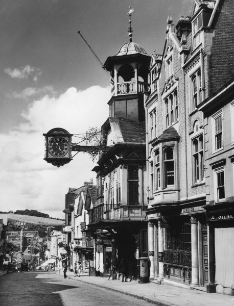 Guildford, Surrey, has one of the finest High Streets in the South of England. Half-way down, is the well-known 16th century clock, outside a very quaint Guild Hall building