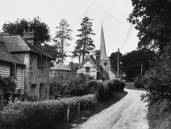 A glimpse of the village and church of Horsted Keynes, Sussex, England