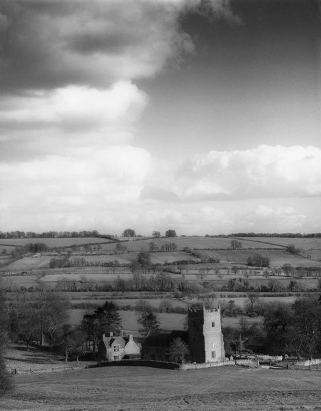 A view over the church at Little Rollright, a village near Chipping Norton, Oxfordshire, England. Date: early 1960s