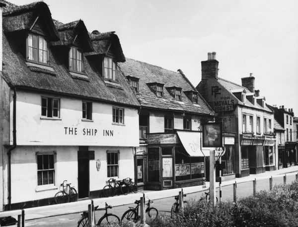 The market town of March, in the Cambridgeshire Fens, England, showing a deserted street, apart from seven bicycles curiously parked outside the Ship Inn!