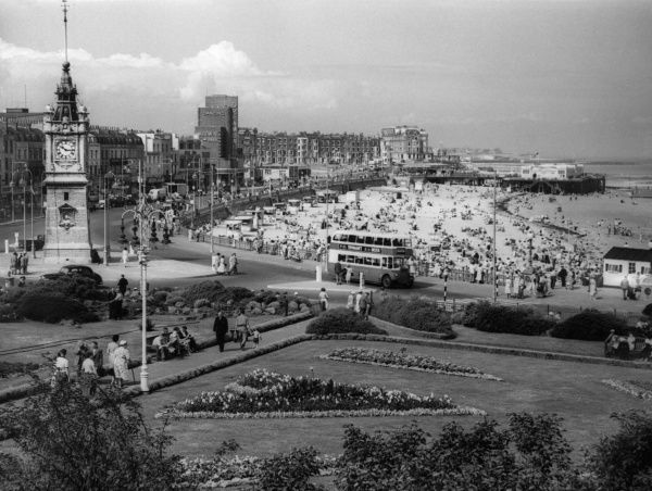 The busy beach, promenade and clock tower at Margate, Kent, England