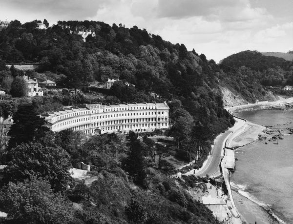 A fine view of Meadfoot, a wooded bay, with the lovely Hesketh Crescent (1848), which incorporates the Osborne Hotel, at Torquay, Devonshire