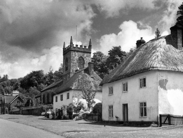 The distinctive charm of the village street and St. James's Church, Milton Abbas, Dorset, England. Built in the 1780s by Sir William Chambers at the request of Lord Milton. Date: 1950s