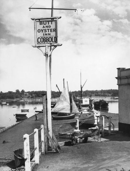 "The waterfront at Pin Mill, Suffolk, with its waterside inn, the ""Butt and Oyster"", overlooking the Orwell Estuary, a favourite resort for fishermen and yachtsmen"