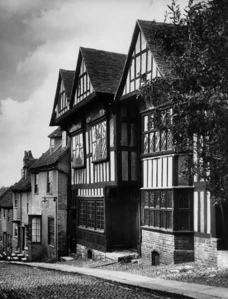 This beautiful half-timbered building in Mermaid Lane, Rye, Sussex, England, is the Old Hospital. A true gem of 'Old England' which has slumbered throughout the centuries. Date: 1939