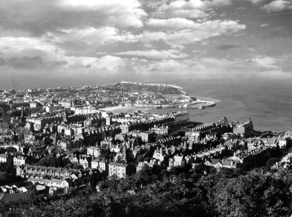 A striking 'bird's eye' impression of the seaside holiday resort of Scarborough, Yorkshire, England, seen from Oliver's Mount. Date: late 1950s