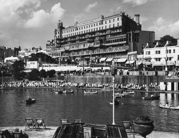 A glimpse of Pier Hill, seen from across the Boating Lake, Southend-on-Sea, Essex, with the impressive Palace Hotel in the background