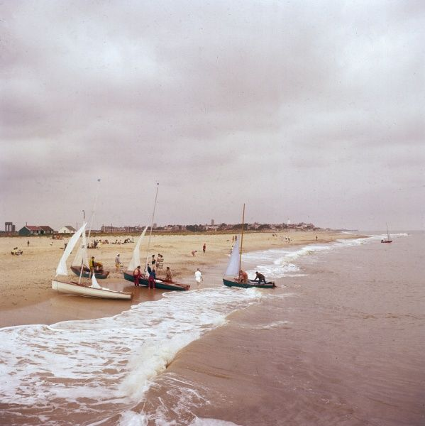Sailing ships on the beach at Southwold, Suffolk, England. Date: 1960s