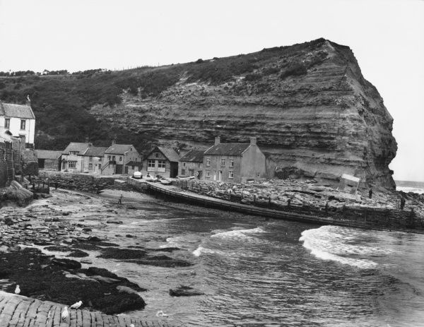 The picturesque Yorkshire fishing village of Staithes, with its little harbour below the cliffs