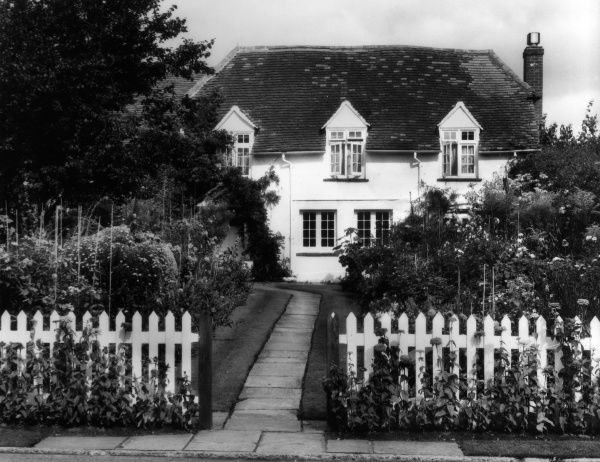 A trim cottage and garden at Chobham, Surrey, England. Date: 1950s