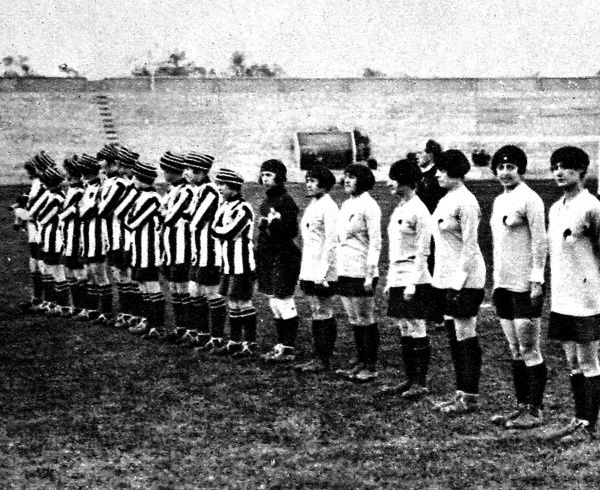 Photograph showing an English team (left in striped shirts) from the Dick Kerr electrical works, Preston, and a French women's football team, prior to a match held at the Pershing Stadium, Paris, 1920. The match was watched by 12,000 spectators