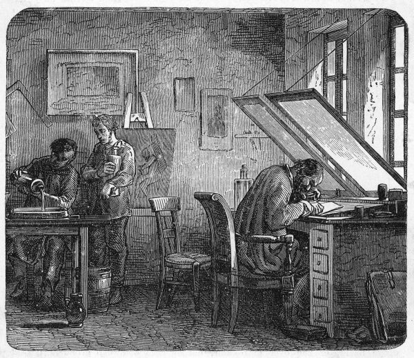 An engraver and his assistants at work in a French atelier