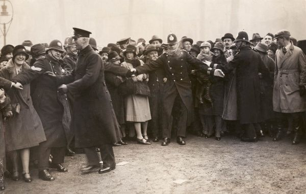 A crowd scene at the enthronement of the new Archbishop of Canterbury, Cosmo Gordon Lang (1864-1945)